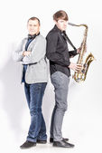 Saxophonist and DJ posing in studio — Stock Photo