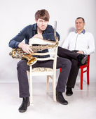 Man in white shirt and saxophonist — Stock Photo