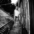 Girl standing near old grungy building — Stock Photo #33058805