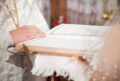 Priest giving Bible to bride — Stock Photo
