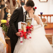 Stock Photo: Married couple kissing in orthodox church