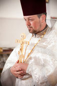 Orthodox priest holding crucifix — Photo