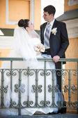 Couple standing on balcony — Stock Photo