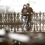 Young couple hugging in bridge — Stock Photo