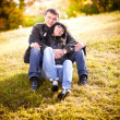 Couple in love sitting on hill — Stock Photo