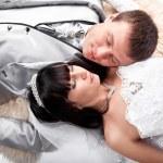 Married couple lying on floor — Stock Photo