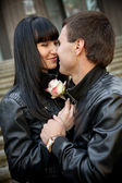 Handsome man giving rose to his girlfriend — Stock Photo