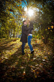 Young couple standing in park — Stock Photo