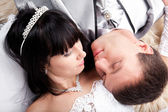 Newly married couple lying together — Stock Photo