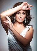 Brunette lady in white singlet — Stock Photo