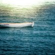 Lonely boat floating on waves — Stock Photo #33298831