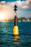Buoy with red light in sea — Stock Photo