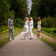 Stock Photo: Newly married couple hugging on road in park