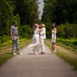 Newly married couple hugging on road in park — Stock Photo
