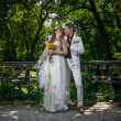 Stock Photo: Married couple in white clothes hugging in park