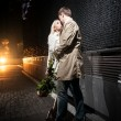 Stock Photo: Couple in love hugging on street at night