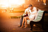 Couple in love hugging on bench — Stock Photo