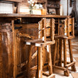 Stock Photo: Two high wooden bar chairs in country style