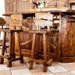 Stock Photo: High wooden bar chairs standing near bar desk
