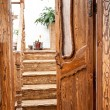 Wooden door with glass leading to stairway — Stock Photo