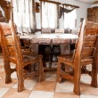 big wooden table with chairs — Stock Photo