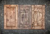 Three toned wooden doors — 图库照片