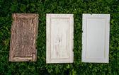 Wooden doors lying on grass — 图库照片