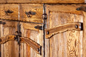 Wooden cupboard doors with forged metal handles — Stock Photo