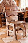 Wooden chair standing in dining room — Stock Photo
