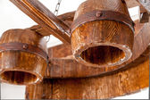 Massive wooden lamp hanging under ceiling — Foto de Stock