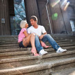Couple in love hugging on stairs against old columns — Stock Photo