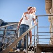 Couple in love hugging on metal staircase — Stock Photo