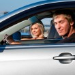 young man and girl sitting in two cars — Stock Photo