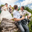 Groom drinking beer with friend while bride arguing — Stock Photo