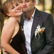 groom hugging woman and making faces — Stock Photo