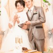 Bride and groom showing wedding document — Stock Photo