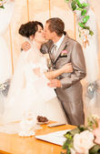 Married couple kissing first time in wedding office — Stock Photo