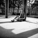 Photo of sexy girl sitting near urban columns — Stock Photo #34196417