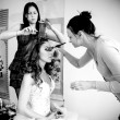 Makeup artist and hairdresser preparing bride for wedding — Stock Photo