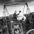 Photo of married couple riding on ferris wheel — Stock Photo