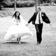 newly married couple running in park — Stok fotoğraf