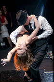 Couple dancing argentinian tango on stage — Stock Photo