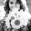 closeup portrait of girl with sunflowers — Stock Photo