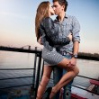 Man and sexy woman hugging passionately on embankment — Stock Photo