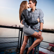 Man and sexy woman hugging passionately on embankment — Stock Photo #34967617