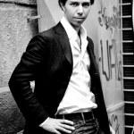 Elegant man posing against street — Stock Photo #35121269