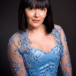 Stock Photo: Portrait of brunette lady with short haircut and in blue corset