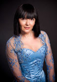 Portrait of brunette lady with short haircut and in blue corset — Stock Photo