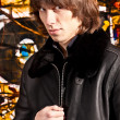 Portrait of man with long hear wearing leather coat — ストック写真