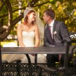 Newly married couple talking on summer terrace — Stock Photo